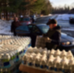 Volunteers provide cases of water to citizen's of Flint during water crisis. (Photo by Tony Lynn)