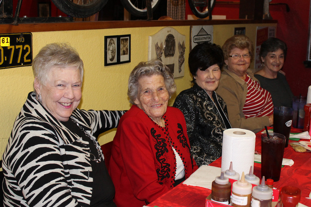 Attendees are all smiles at an annual Christmas dinner for widows and widowers in First Baptist Church in Searcy, Ark. (Photo courtesy of Amy Roussel)