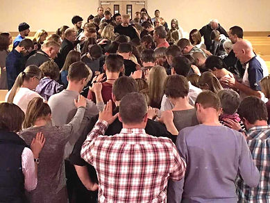 Members of Calvary Church, a church replant in La Junta, Colo., gather for corporate prayer following a worship service. The church is a replant of Calvary Church in Englewood, Colo., itself a church replant. The Englewood church has helped replant six churches in the metro Denver area. (Photo courtesy Calvary Church)