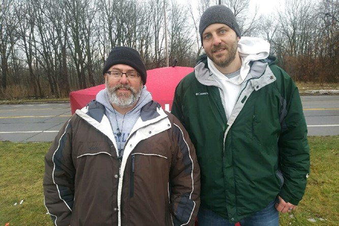 A red tent in a parking lot across from an abortion clinic marks the spot where fulltime missionary James Carr (left) seeks to help expectant mothers turn from abortion in a ministry launched by ONElife Church in Flint, Mich. Church member Justin Phillips (right) assists at the tent 20-25 hours a week in addition to working a fulltime job. Photo submitted