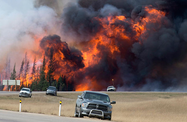 Massive wildfire continues to rip through Western Canada. (Photo courtesy thesun.co.uk)