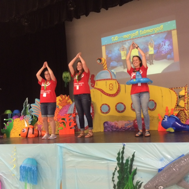 """Students from Springfield lead the children in singing with actions from the """"Submerged"""" VBS Curriculum by LifeWay. (Photo courtesy Garth Leno)"""