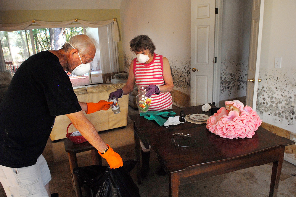Russ and Gerry Frye, married for 61 years, sort through items in their flood damaged home in Longs, S.C. The couple, who had been away during Hurricane Florence's landfall, returned after about three weeks and found mold almost four feet high in every room of their home. (Photo by Laura Sikes/NAMB)