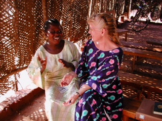 SISTERS IN CHRIST: IMB missionary Barbara Singerman speaks with a young Christian in a Benin church. (IMB Photo)