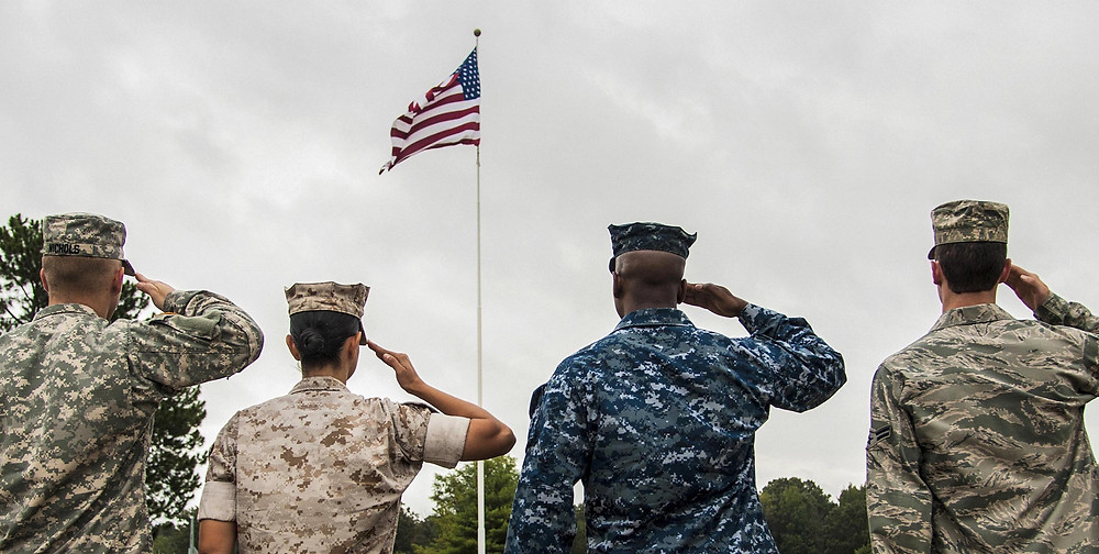 No matter the branch of service, the common denominator is the American flag but also your church.  Take time to minister to them and their families. (Photo courtesy of USDD.gov)