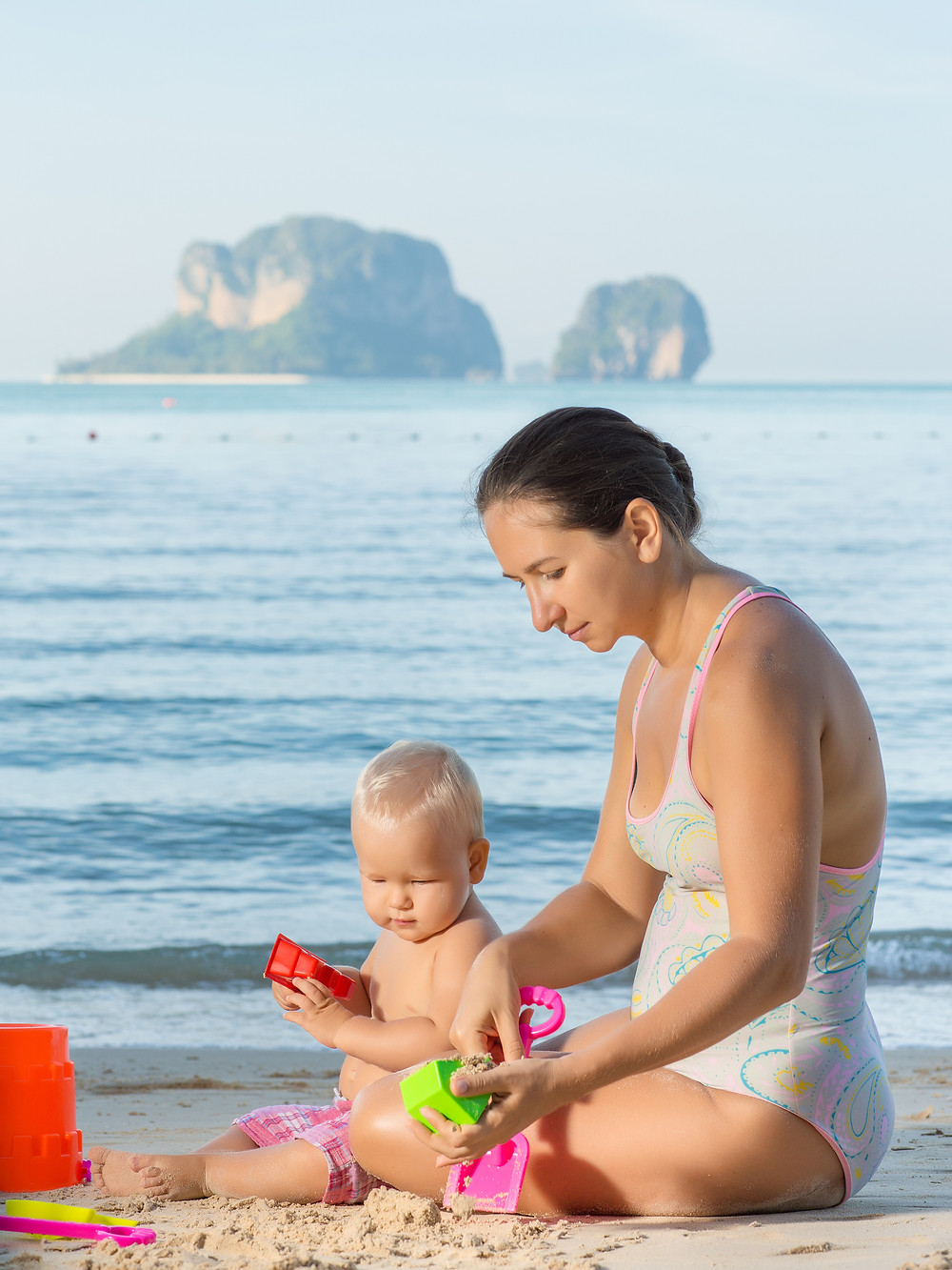 Baby and mom are playing beach toys.jpg