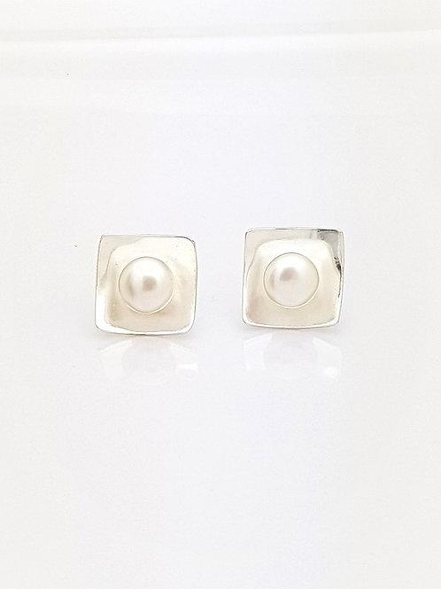 Topos Cuadrados y Perlas