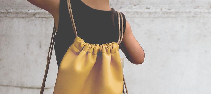 nettomignon-zaino-bimbo-backpack-kid-daen-pastello-giallo