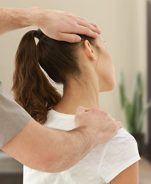 Chiropractor treating female patient