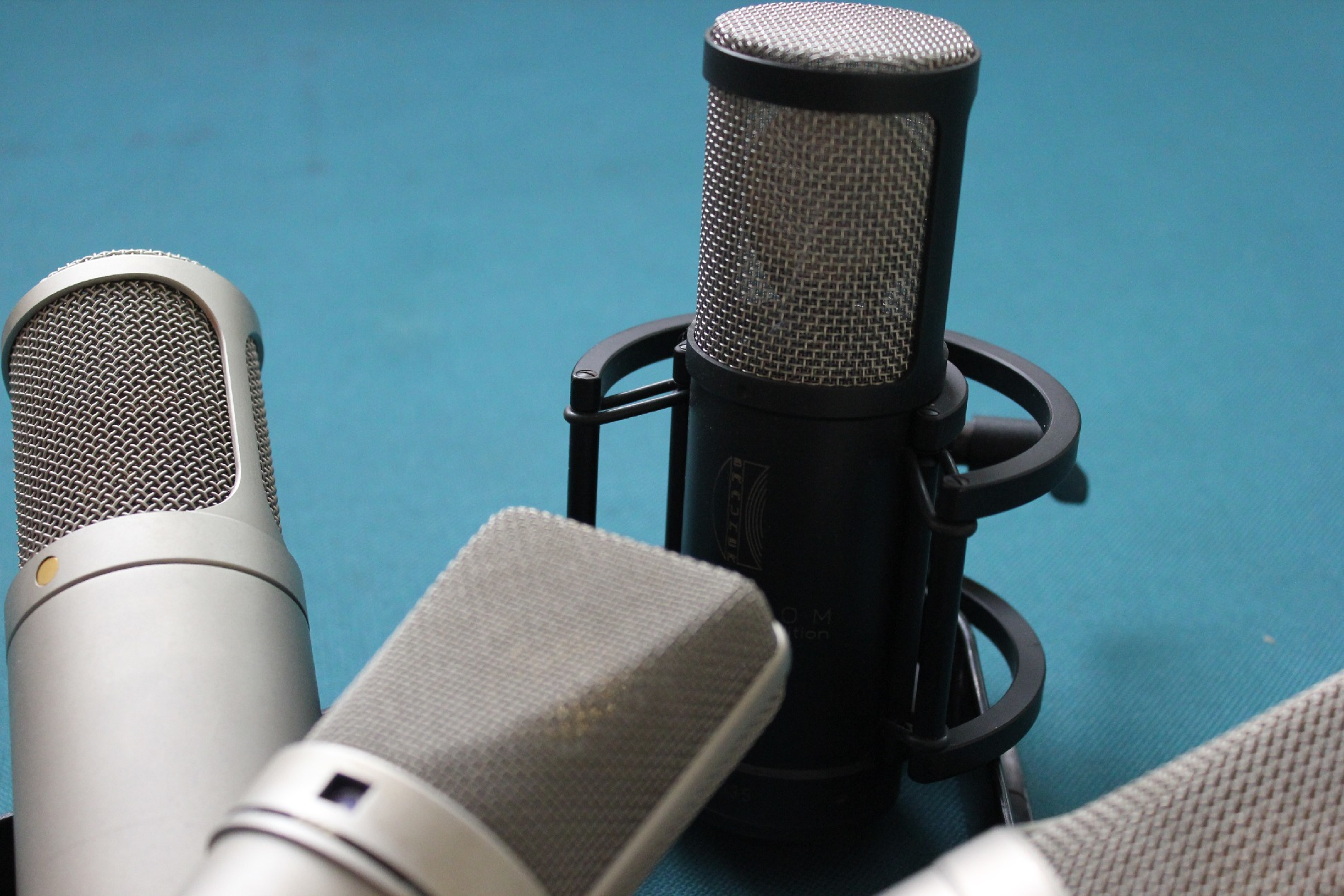 Our voice over mics on table