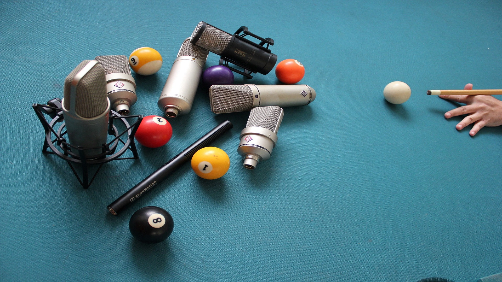 Greek voices mics on a pool table