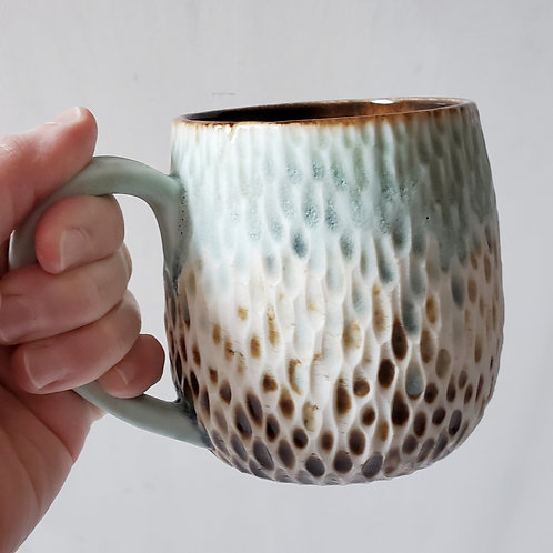Beachy pebble carved mug