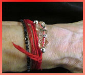 Red thread with beads.jpg
