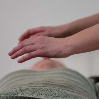 hands of professional healer doing  trea