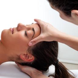 Close up of osteopath doing healing trea