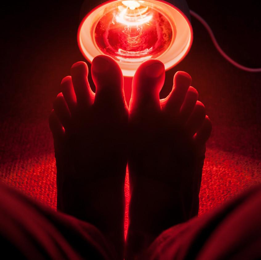 medicinal red-light-lamp radiating at a