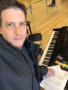 Dustin Leonrd, Artistic Director