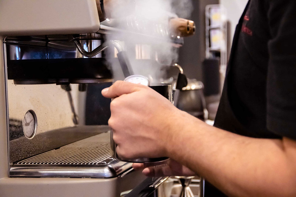 Perk and parcel barista makes an espresso
