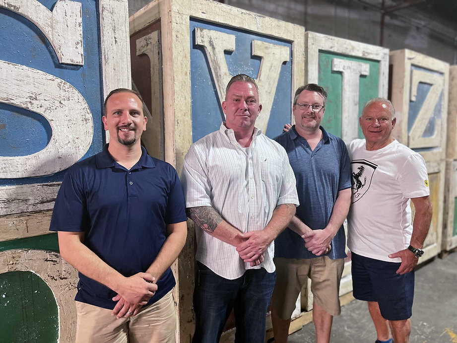 The founders of Hollywood Salavage Shaun Nichols, Mike Gwynn,Andrew J. Boles,Ralph Caruso in their prop house in Devens, MA.