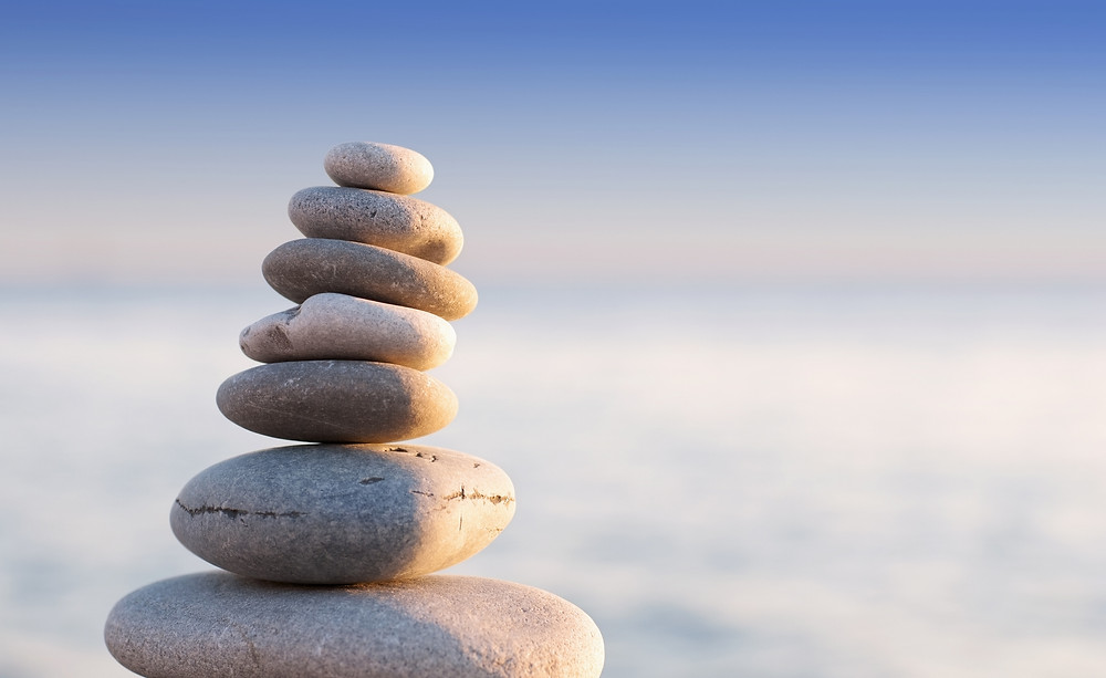 stacked stones represent balanced wellness