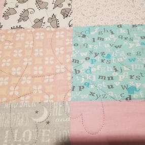 Baby Quilt with Heart Pattern