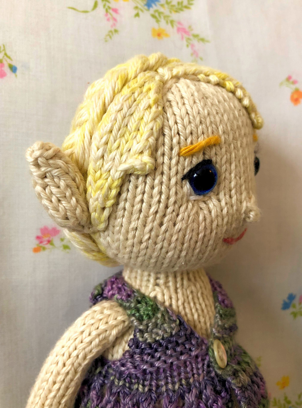 Side view of blond mermaid doll showing double-layer ear style.