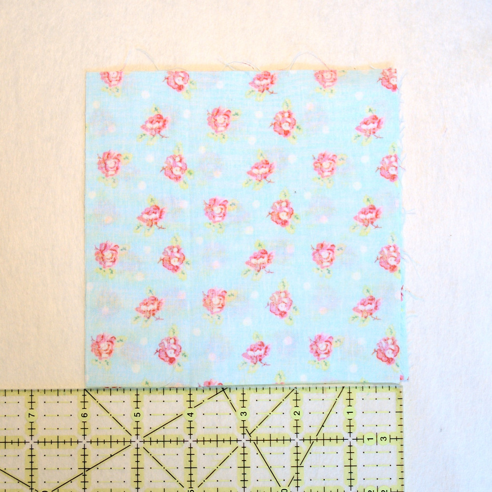 two squares of printed cotton fabric