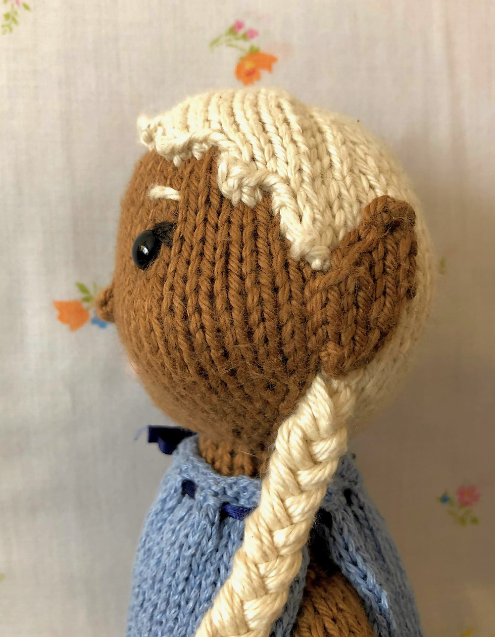 Side view of white haired Elf doll showing single-layer ear style.
