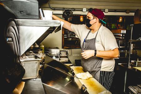 Chef filling sandwich orders