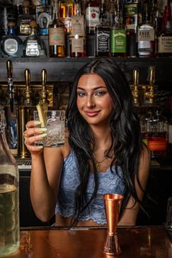 Bartender Alyssa offering up a Spring cocktail at Fino Pizza Bar