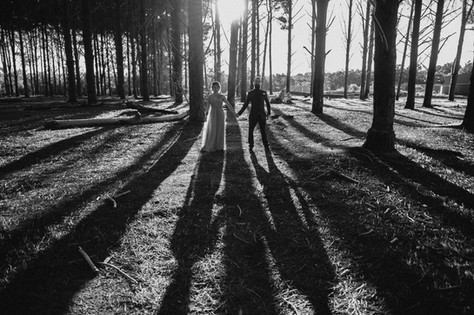 couple in the forest shadows