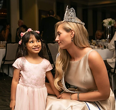 Child and Miss World America .png