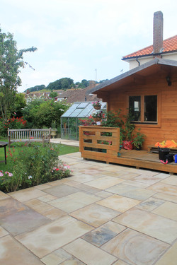 Summerhouse, patio and lawn