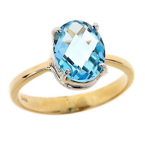 Blue topaz ring in 14 karat yellow & white gold