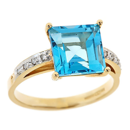 Blue topaz ring 14 kt yellow gold