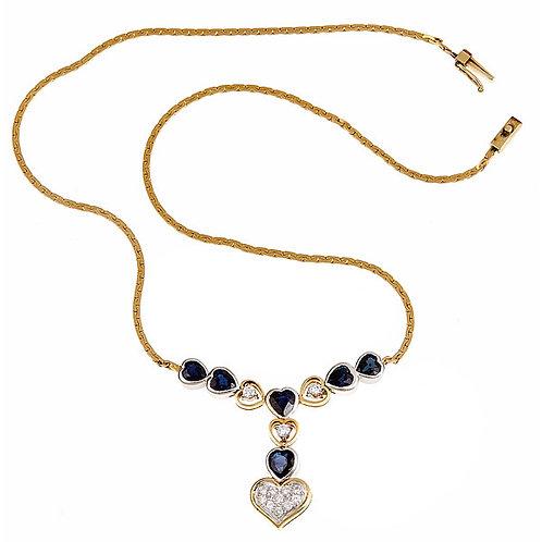 Sapphire and diamond pendant in 14 karat gold