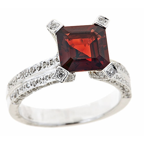 Garnet ring in 14 karat white gold