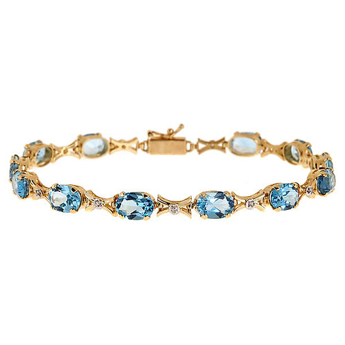Blue topaz diamond bracelet 14 karat yellow gold