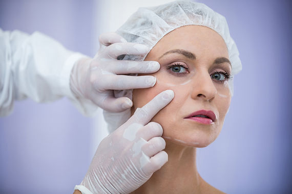 doctor-examining-female-patients-face-co