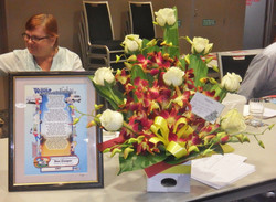 AGM 2014 and flowers presented to the Coopers. Plaque was given to Des in 2007.J