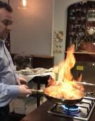 Salvo, the owner performing his flambé skills