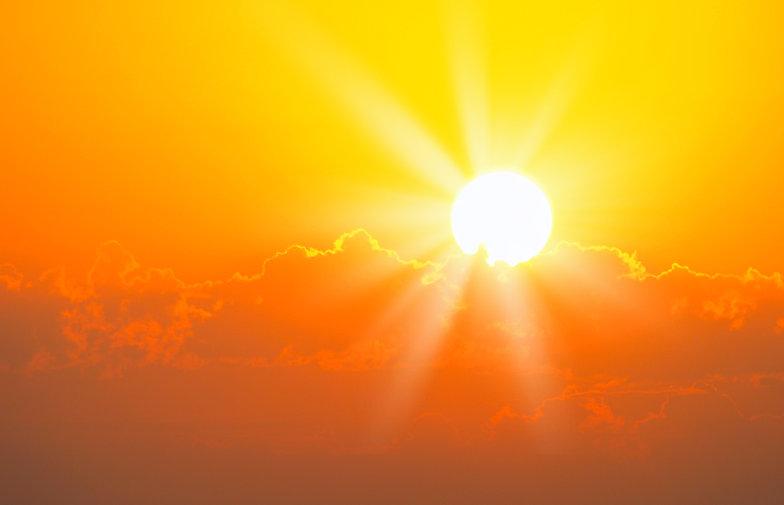 Brilliant orange sunrise over clouds in