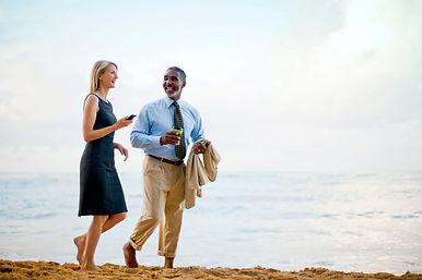 Two business partners enjoy walking on t