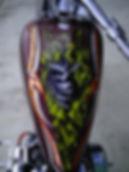 Custom chopper with skulls and flames.  Custom Fabricated back fender.