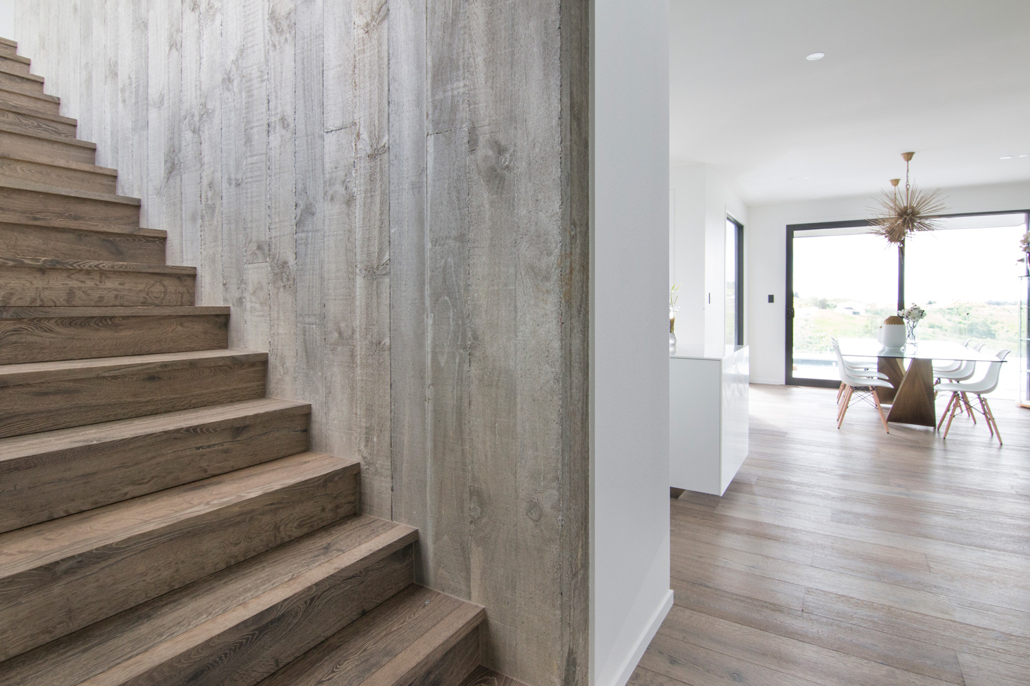 Natural Hardwood Stairs and Wall