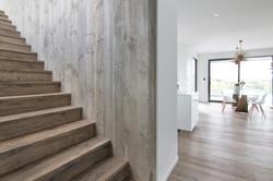 Natural Hardwood Stairs and Wall