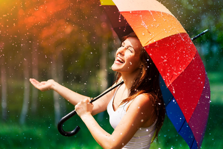 storyblocks-laughing-woman-with-umbrella