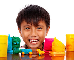 happy-boy-playing-with-colored-dough_M1b