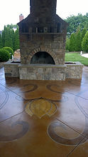 Acid stained concrete patio with custom design