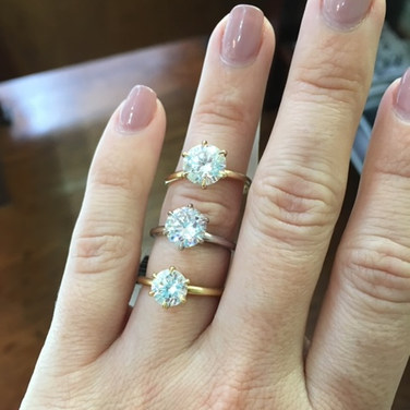 Three round solitare engagement rings